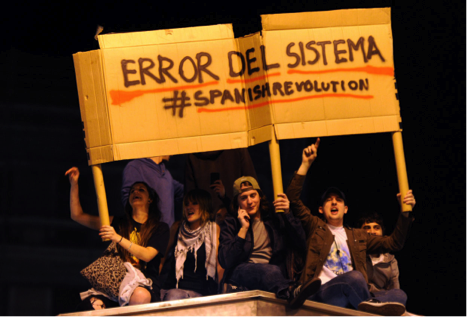 Networking Knowledge: Protest and the New Media Ecology. The issue cover pictures spanish protesters holding banner: ERROR DEL SISTEMA